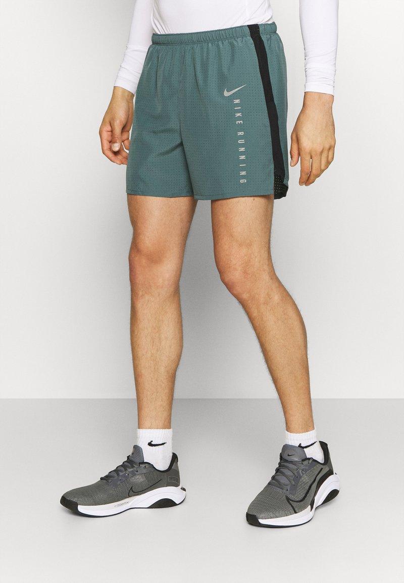 Nike Performance - Sports shorts - hasta/black