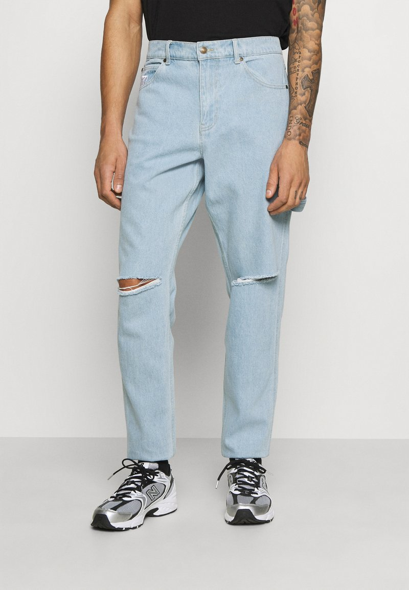 Karl Kani - RINSE PANTS - Relaxed fit jeans - light blue