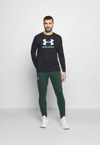 Under Armour - ROCK PANT - Tracksuit bottoms - ivy - 1