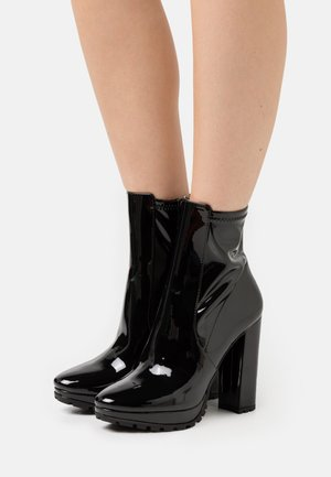 BRIDDA - Platform ankle boots - black