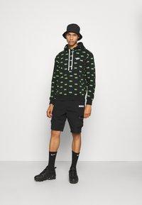 Nike Sportswear - CITY MADE - Shorts - black/black - 1
