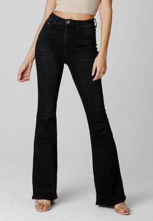 Flared Jeans - schwarz