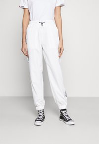 Tommy Jeans - JOGGER TAPE RELAXED - Tracksuit bottoms - white - 0