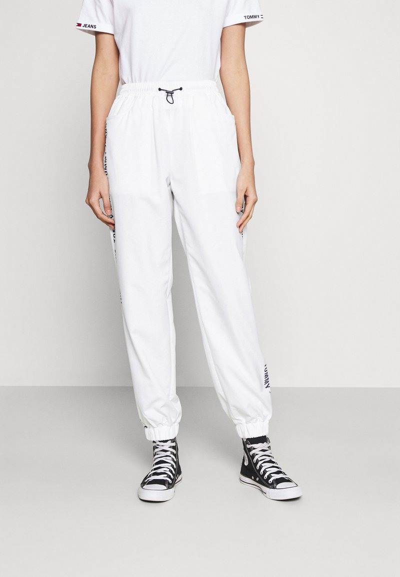 Tommy Jeans - JOGGER TAPE RELAXED - Tracksuit bottoms - white