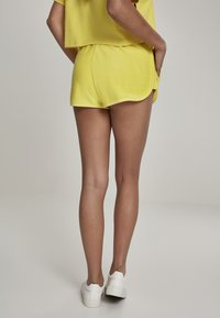 Urban Classics - LADIES TOWEL HOT PANTS - Verryttelyhousut - brightyellow - 1
