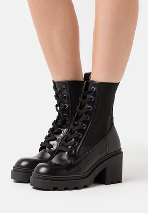 CALISTA - Platform ankle boots - navy blue