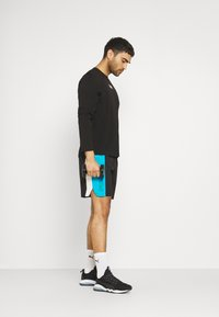 Puma - EXCITE SHORT - Sports shorts - black - 1