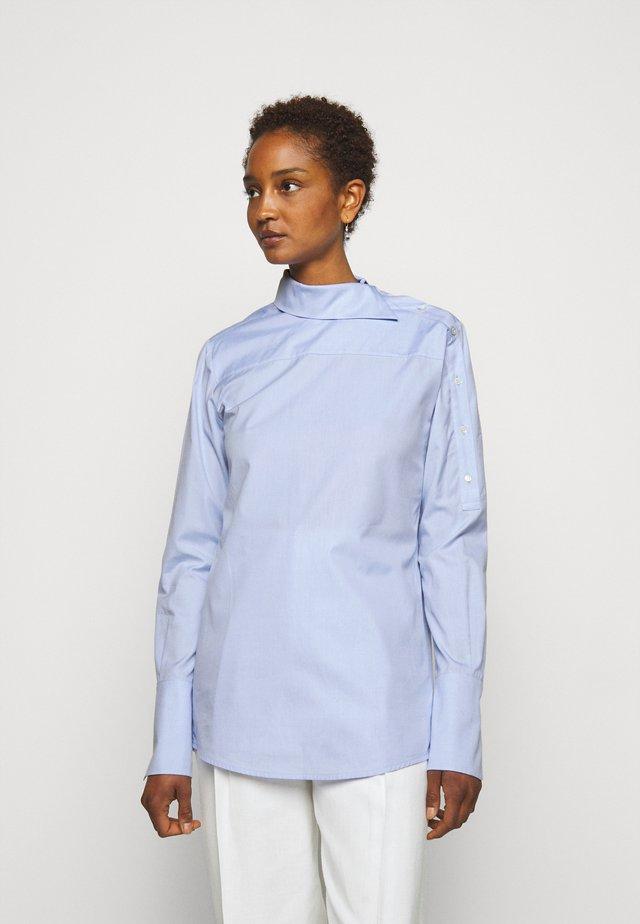 ASYMMETRIC OXFORD - Button-down blouse - oxford blue