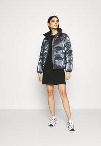Calvin Klein Jeans - IRIDESCENT STAND COLLAR PUFFER - Winter jacket - gentian violet - 1
