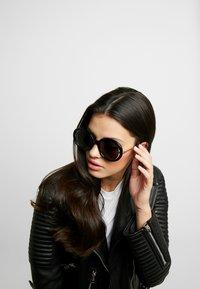 Alexander McQueen - Sunglasses - black/grey - 1