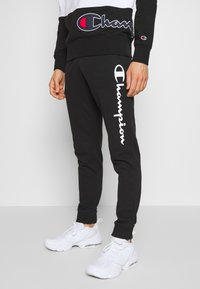 Champion - CUFF PANTS - Trainingsbroek - black - 0