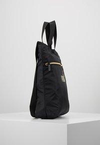 Puma - CORE SEASONAL SHOPPER - Tote bag - black/gold - 3