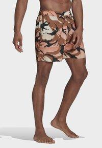 adidas Performance - SHORT-LENGTH GRAPHIC SWIM SHORTS - Swimming shorts - brown - 2