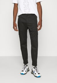 HUGO - FAREL - Cargo trousers - black - 0