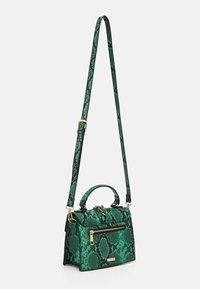 ALDO - SNAKE - Handbag - green - 1