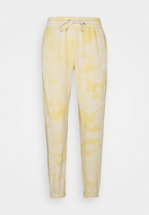 EASY - Tracksuit bottoms - yellow tie dye
