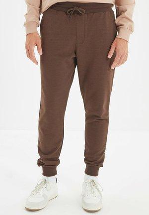 PARENT - Tracksuit bottoms - brown