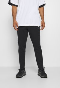 adidas Performance - STRIPES MUST HAVES SPORTS REGULAR PANTS - Verryttelyhousut - black - 0