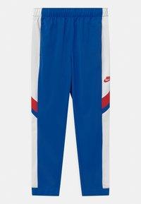 Nike Sportswear - POLY SET UNISEX - Tracksuit - game royal/white/university red - 2