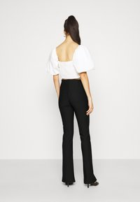 Gina Tricot - FRONT SLIT TROUSERS - Trousers - black - 2