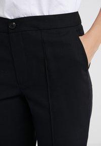 McQ Alexander McQueen - CIGARETTES PANTS - Bukse - black - 4