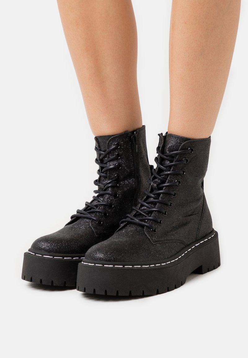 Steve Madden - SKYLAR - Platform ankle boots - black