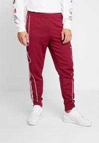 adidas Originals - OUTLINE STRIKE REGULAR TRACK PANTS - Tracksuit bottoms - mystery ruby - 0