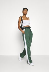 Missguided - PLAYBOY VARSITY WIDE LEG TRICOT PANTS - Tracksuit bottoms - green - 1
