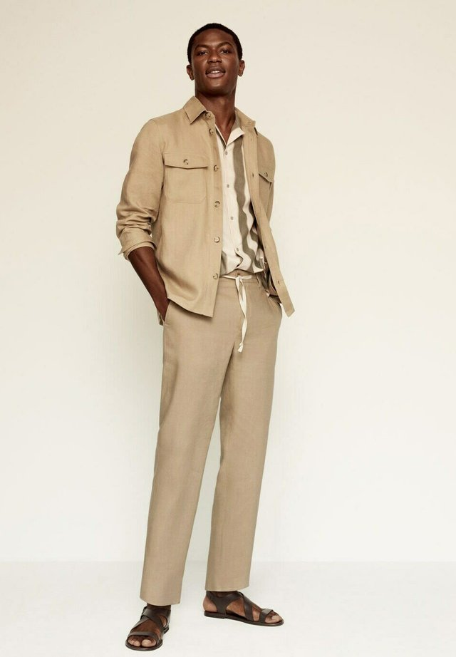 RELAXED FIT - Bukse - beige