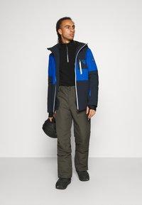 Brunotti - FOOTSTRAP MENS SNOWPANTS - Zimní kalhoty - pine grey - 1