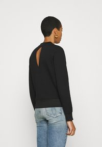 Calvin Klein Jeans - CUT OUT BACK  - Sweatshirt - black - 2