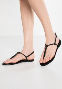 KIOMI - T-bar sandals - black - 0