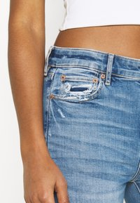 American Eagle - SUPER HIGH RISE - Flared Jeans - cool hand blue - 4