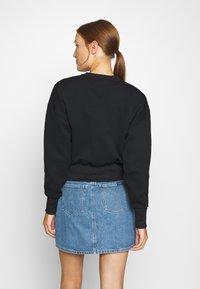 Calvin Klein Jeans - BADGE INTERLOCK - Long sleeved top - black - 2