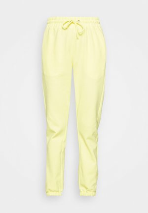 NEMA - Tracksuit bottoms - sunshine