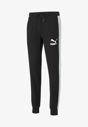 ICONIC - Tracksuit bottoms - puma black