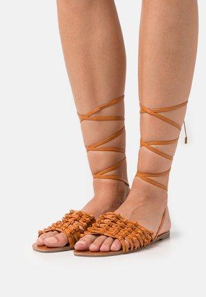 CROCHET TIE UP FLAT - Sandals - tan
