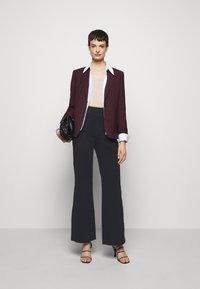 Filippa K - JANNIE TROUSER - Kalhoty - black - 1