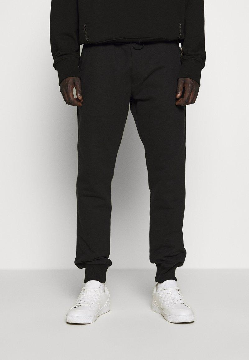 Versace Jeans Couture - BASIC JOGGERS - Tracksuit bottoms - black