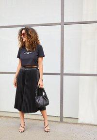 Juicy Couture - CROWN - T-shirt print - black - 1