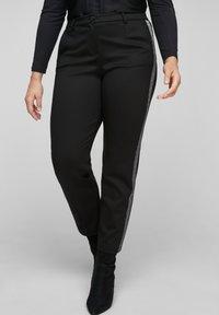 Triangle - MIT GLITZER-GALONSTREIFEN - Trousers - black - 0