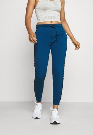 JANTE - Teplákové kalhoty - poseidon