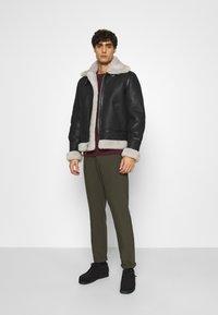 Schott - Leather jacket - black/offwhite - 1