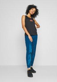 Nike Performance - AIR PANT - Teplákové kalhoty - valerian blue - 1
