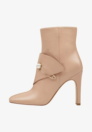 High heeled ankle boots - light beige