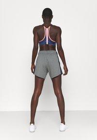 Nike Performance - INDY PRO BRA - Light support sports bra - bright mango/white/midnight navy/metallic silver - 2