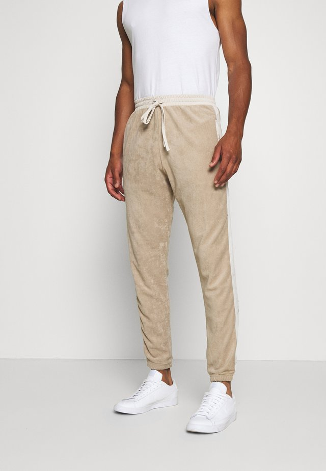 TRACKPANTS LOUNGIN - Verryttelyhousut - beige/off white