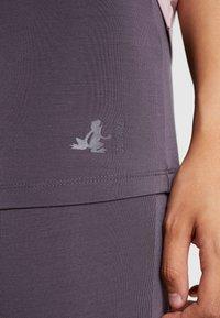 Curare Yogawear - LONG PANTS SKIRT - Tracksuit bottoms - aubergine - 4