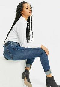 WE Fashion - Slim fit jeans - blue - 4