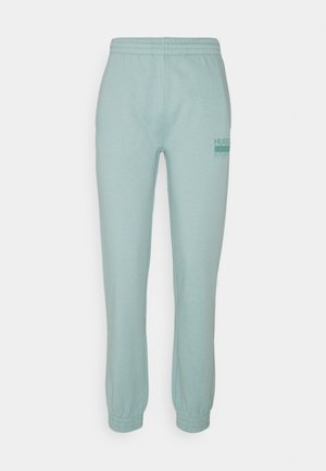 NAJOGGER - Tracksuit bottoms - light/pastel green
